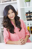 Asian Chinese Woman Girl in Kitchen Stock Photo