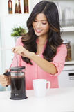 Asian Chinese Woman Girl in Kitchen Making Coffee Royalty Free Stock Photo