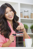 Asian Chinese Woman Girl in Kitchen Making Coffee Stock Photography