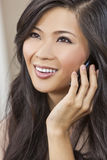 Asian Chinese Woman Girl Talking on Cell Phone Royalty Free Stock Image