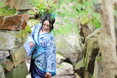 Free Asian Chinese Woman In Traditional Blue And White Hanfu Dress, Play In A Famous Garden Stock Image - 94164341