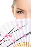 Asian chinese woman looking seductive with paper fan Royalty Free Stock Photos