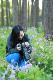 Portrait of a Asian Chinese nature woman photographer look at her camera screen in a spring park forest , with good hand gesture stock image
