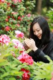 Nature travel photographer woman with Sunshine in spring, looking at carmer screen. Asian chinese Woman Nature travel photographer woman taking pictures in Royalty Free Stock Photos