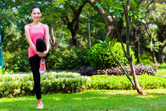 Asian Chinese woman at outdoor fitness training stock photography