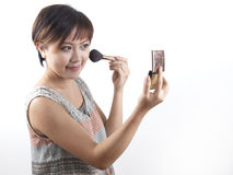 Asian Chinese Woman putting on make up Stock Photography