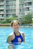 Asian Chinese Woman smiling confidently in swimming pool stock photos