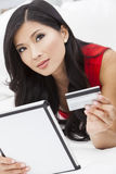 Asian Chinese Woman Tablet Computer Credit Card Stock Images