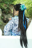 Asian Chinese woman in traditional Blue and white Hanfu dress, play in a famous garden ,Stand in front of the window. Qiyuan Garden is one of the ten famous royalty free stock photography