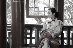 Asian Chinese woman in traditional cheongsam enjoy free time Stock Images