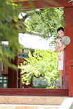 Asian Chinese woman in traditional cheongsam enjoy free time Stock Photos