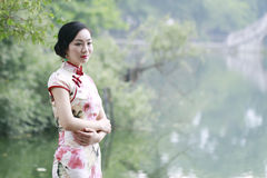 Asian Chinese woman in traditional cheongsam Stock Image