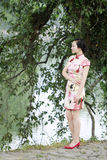 Asian Chinese woman in traditional cheongsam Stock Photography
