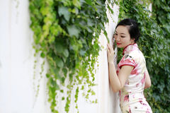 Asian Chinese woman in traditional cheongsam Royalty Free Stock Images