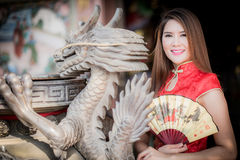Asian Chinese woman in Traditional Chinese. By background ambience China royalty free stock image