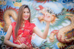 Asian Chinese woman in Traditional Chinese. By background ambience China royalty free stock photography