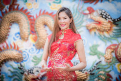 Asian Chinese woman in Traditional Chinese. By background ambience China royalty free stock photos