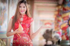 The Asian Chinese woman in Traditional Chinese hold calabash royalty free stock photos