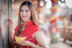The Asian Chinese woman in Traditional Chinese hold Chinese mon. Asian Chinese woman in Traditional Chinese hold Chinese money royalty free stock photos