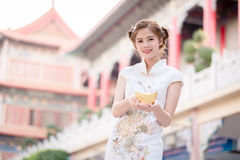The Asian Chinese woman in Traditional Chinese hold Chinese mon stock photography