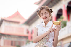 The Asian Chinese woman in Traditional Chinese hold Chinese mon royalty free stock images