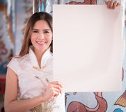 The Asian Chinese woman in Traditional Chinese hold empty blank. Asian Chinese woman in Traditional Chinese hold empty blank board stock photo