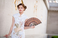 Asian Chinese woman in Traditional Chinese hold Fanning paper Stock Image