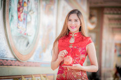 Asian Chinese woman in Traditional Chinese hold Gift Bag. By background ambience China stock photos