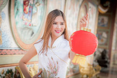 Asian Chinese woman in Traditional Chinese hold red paper lant. Asian Chinese woman in Traditional Chinese hold red paper ,by background ambience China stock photography