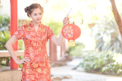 The Asian Chinese woman in Traditional Chinese hold red paper Royalty Free Stock Image