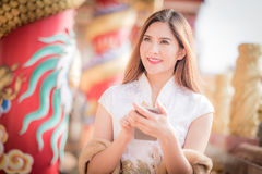 The Asian Chinese woman in Traditional Chinese and hold telepho. Asian Chinese woman in Traditional Chinese and hold telephone royalty free stock photography