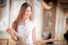 The Asian Chinese woman in Traditional Chinese and hold telepho. Asian Chinese woman in Traditional Chinese and hold telephone stock photos
