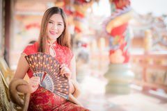 The Asian Chinese woman in Traditional Chinese holding blow. Asian Chinese woman in Traditional Chinese holding blow royalty free stock photos