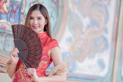 The Asian Chinese woman in Traditional Chinese holding blow. Asian Chinese woman in Traditional Chinese holding blow royalty free stock photography