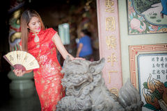 Asian Chinese woman in Traditional Chinese holding blow. By background ambience China stock photo