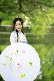 Asian Chinese woman in traditional Hanfu dress,classic beauty in Chin. Asian Chinese woman in traditional Hanfu dress, tour at ancient old history culture royalty free stock photos