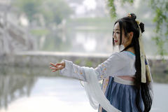 Asian Chinese woman in traditional Hanfu dress,classic beauty in Chin. Asian Chinese woman in traditional Hanfu dress, tour at ancient old history culture town Stock Photos