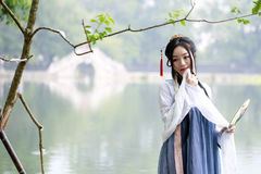 Asian Chinese woman in traditional Hanfu dress,classic beauty in Chin Royalty Free Stock Photography