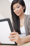 Asian Chinese Woman Using Tablet Computer Stock Photos