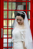 Asian Chinese woman in wedding dress Stock Image