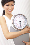 Asian Chinese Woman With Weighing Scales at Gym Stock Images