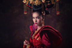 Asian Chinese women. Asian Chinese woman in national dress Royalty Free Stock Images