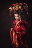 Asian Chinese women. Asian Chinese woman in national dress Royalty Free Stock Photo