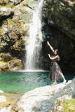 Asian Chinese Young girl dance before waterfall. Asian Chinese Young beautiful woman enjoy free time, beautiful graceful girl, healthy living concept, pure Royalty Free Stock Images