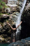 Asian Chinese Young girl dance before waterfall. Asian Chinese Young beautiful woman enjoy free time, beautiful graceful girl, healthy living concept, pure Royalty Free Stock Photography