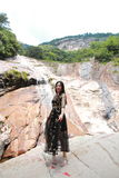Asian Chinese Young girl dance before waterfall. Asian Chinese Young beautiful woman enjoy free time, beautiful graceful girl, healthy living concept, pure Royalty Free Stock Photos