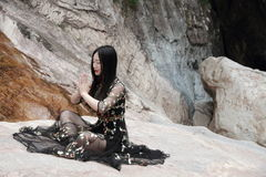 Asian Chinese Young girl do yoga before waterfall. Asian Chinese Young beautiful woman enjoy free time, beautiful graceful girl, healthy living concept, pure Stock Photo