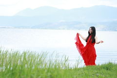 Asian Chinese Young girl enjoy brilliant life by Yunnan erhai. Asian Chinese Young beautiful woman enjoy free time, beautiful graceful girl, healthy living Royalty Free Stock Image