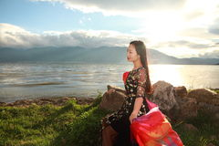 Asian Chinese Young girl enjoy sunshine by erhai, enjoy peaceful life. Asian Chinese Young beautiful woman enjoy free time, beautiful graceful girl, healthy Royalty Free Stock Photos