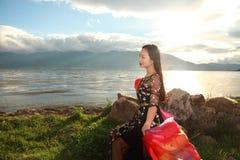 Asian Chinese Young girl enjoy sunshine by erhai, enjoy peaceful life Royalty Free Stock Photos